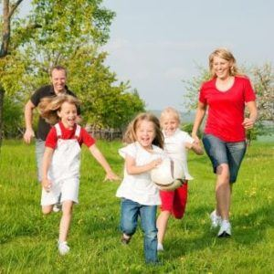 active family running in grass