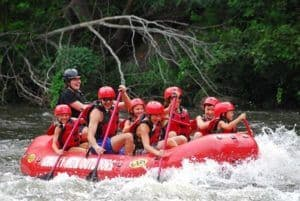 family and guide rafting through lower whitewater