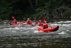 A group of people enjoying a Smoky Mountain kayaking trip.