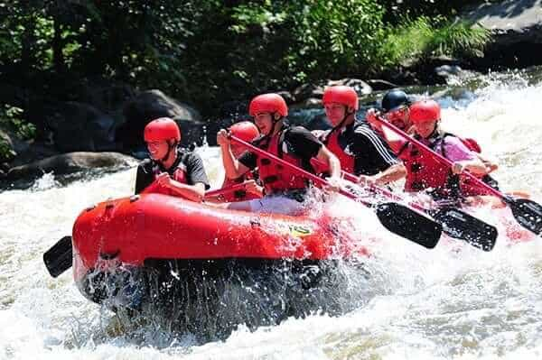 A happy group of people going Upper Pigeon River rafting.