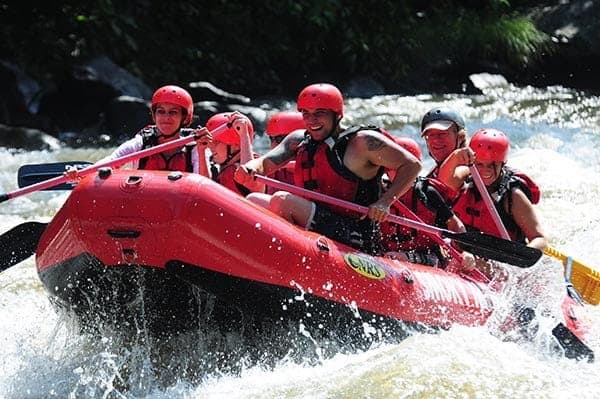 A happy group enjoying Gatlinburg TN white water rafting.