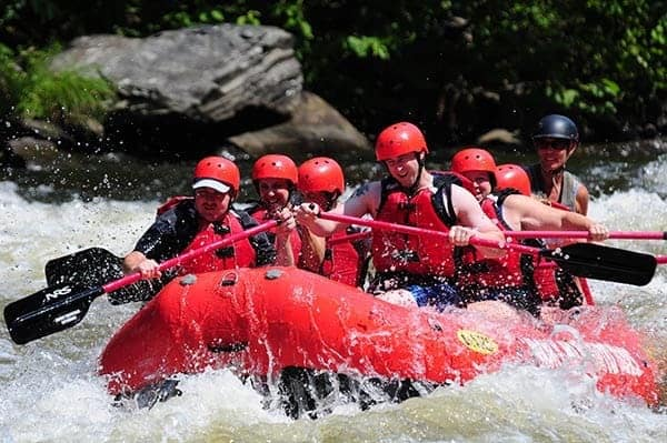 A group of friends enjoying the best white water rafting in Gatlinburg TN.