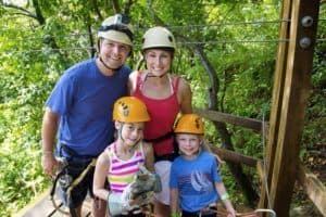 A happy family at a zipline course.