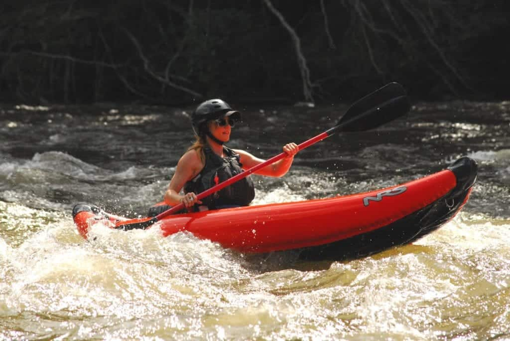 Woman Kayaking with Smoky Mountain Outdoors on Lower Pigeon River