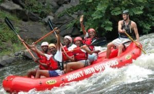 Excited family enjoying rafting with Smoky Mountain Outdoors