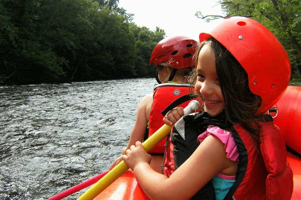 kid white water rafting in the smoky mountains